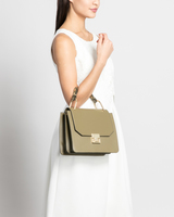 Hopewell top handle bag olive front on model ivanka trump