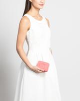 Mara zip around wallet tea rose front on model ivanka trump