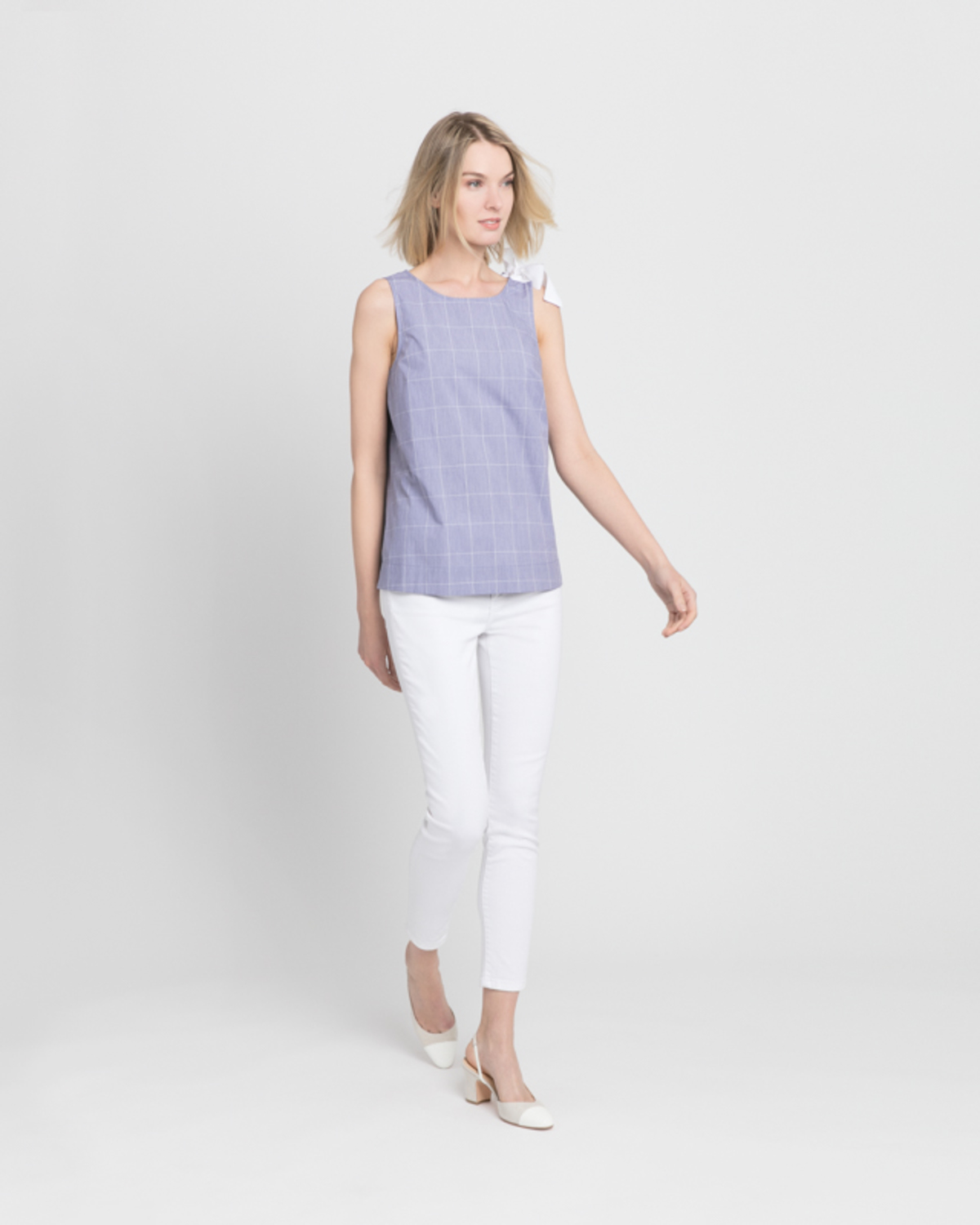 Sleeveless blouse with bow detail blue ivory front ivanka trump
