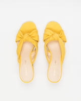 Earin sandals above yellow ivanka trump
